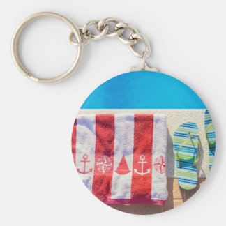 Bathing slippers and bath towel at swimming pool key ring