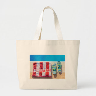 Bathing slippers and bath towel at swimming pool large tote bag
