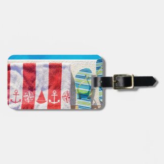 Bathing slippers and bath towel at swimming pool luggage tag