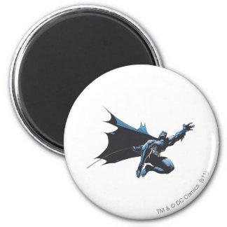 Batman reaches fridge magnet