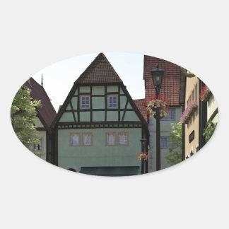 Bavarian Town Street Corner Scene Oval Sticker