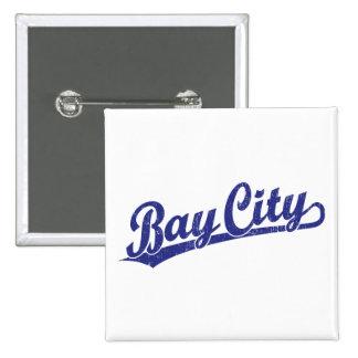 Bay City script logo in blue Buttons