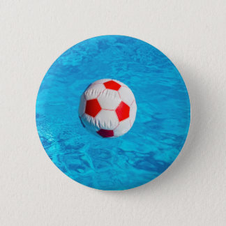 Beach ball floating  in blue swimming pool 6 cm round badge