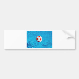 Beach ball floating  in blue swimming pool bumper sticker