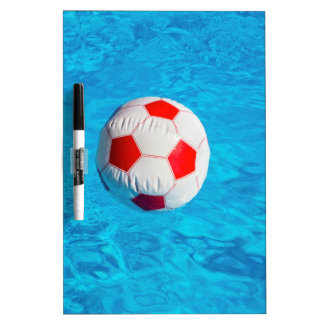 Beach ball floating  in blue swimming pool dry erase board