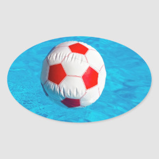 Beach ball floating  in blue swimming pool oval sticker