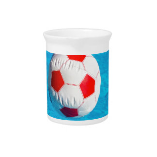 Beach ball floating  in blue swimming pool pitcher