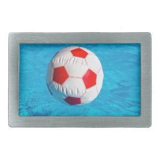 Beach ball floating  in blue swimming pool rectangular belt buckle