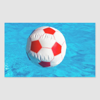 Beach ball floating  in blue swimming pool rectangular sticker