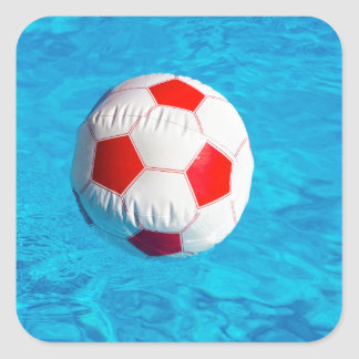 Beach ball floating  in blue swimming pool square sticker