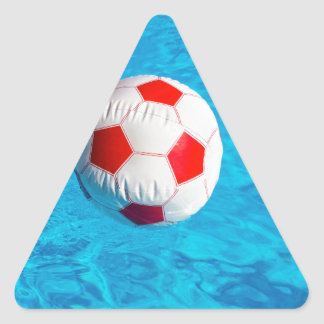 Beach ball floating  in blue swimming pool triangle sticker
