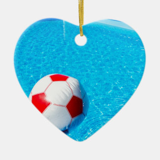 Beach ball floating on water in swimming pool ceramic ornament