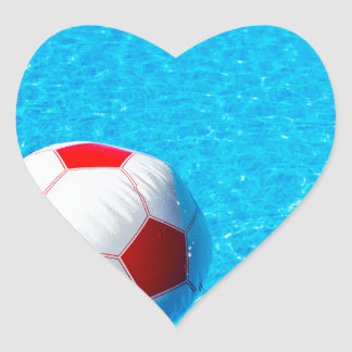 Beach ball floating on water in swimming pool heart sticker