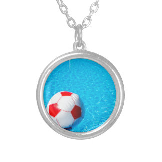 Beach ball floating on water in swimming pool silver plated necklace