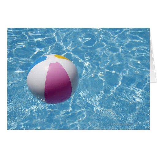 Beach ball in swimming pool greeting card