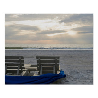 Beach chairs on St. Pete's beach at sunset. Poster