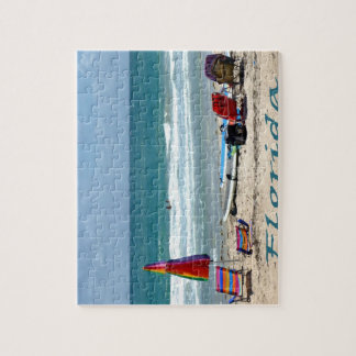 beach chairs surfboards umbrellas sand ocean jigsaw puzzle