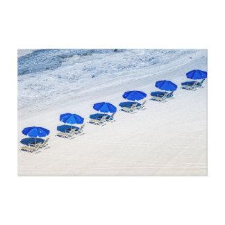 Beach Chairs with Blue Umbrellas on Madeira Beach Canvas Print