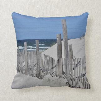 Beach fence and sand dunes cushion