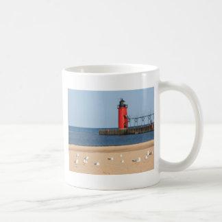 Beach scene with seagulls and lighthouse basic white mug