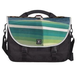 Beach umbrella on sea background laptop commuter bag