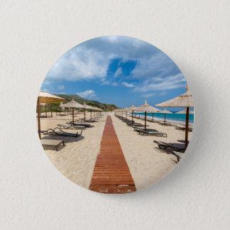 Beach umbrellas and loungers at greek sea 6 cm round badge