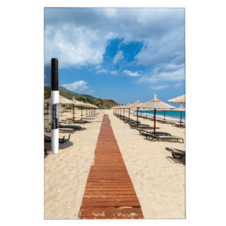 Beach umbrellas and loungers at greek sea dry erase board