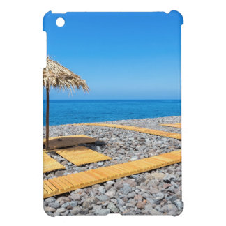 Beach umbrellas with path and stones at coast cover for the iPad mini