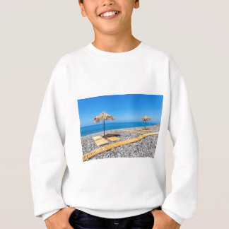 Beach umbrellas with path and stones at coast sweatshirt
