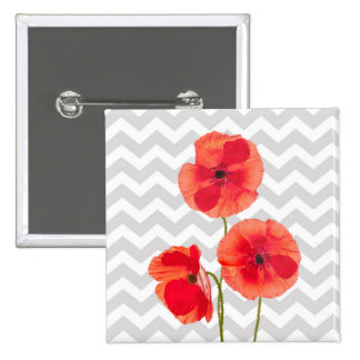 Beautiful blooming red poppies over grey chevron button