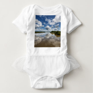 Beautiful clouds over river, reflection in water baby bodysuit