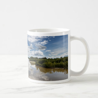 Beautiful clouds over river, reflection in water coffee mug