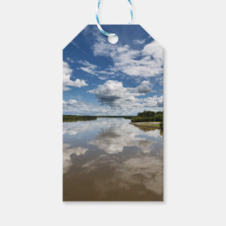 Beautiful clouds over river, reflection in water gift tags