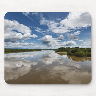 Beautiful clouds over river, reflection in water mouse pad