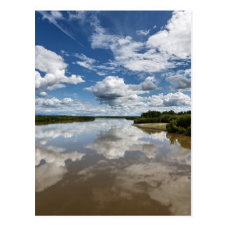 Beautiful clouds over river, reflection in water postcard