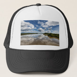 Beautiful clouds over river, reflection in water trucker hat