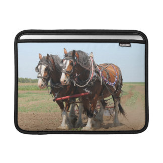 Beautiful clydesdale horses ploughing MacBook sleeve