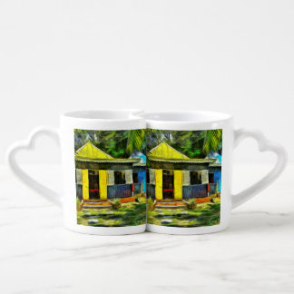 Beautiful colored cottages in a resort couples mug