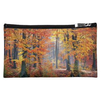 Beautiful colorful autumn forest sunbeams makeup bag