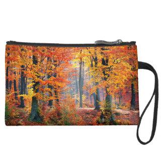 Beautiful colorful autumn forest sunbeams suede wristlet
