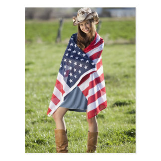 Beautiful cowgirl wrapped in American flag Postcard