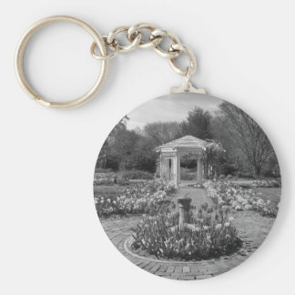 Beautiful Flower lined brick walkway in garden Basic Round Button Key Ring