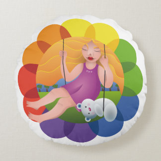 Beautiful girl in swing with its bear round cushion