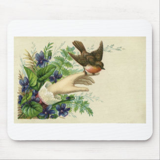 Beautiful hand with A bird and flowers Mousepads
