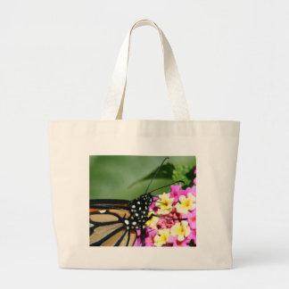 Beautiful Monarch Butterfly on Lantana Flower Canvas Bags