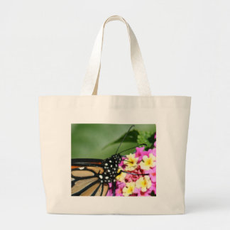 Beautiful Monarch Butterfly on Lantana Flower Canvas Bags