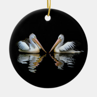 Beautiful pelicans reflection on black background ceramic ornament