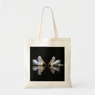 Beautiful pelicans reflection on black background tote bag