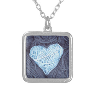 Beautiful photograph of blue wool heart silver plated necklace