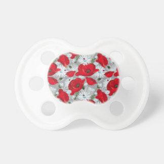 Beautiful red poppy, white daisies and ladybug dummy